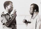 James Baldwin and Chinua walking on the beach